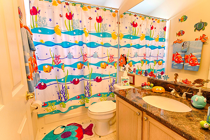 Finding dory nemo themed kids room orlando insider vacations for Space themed bathroom
